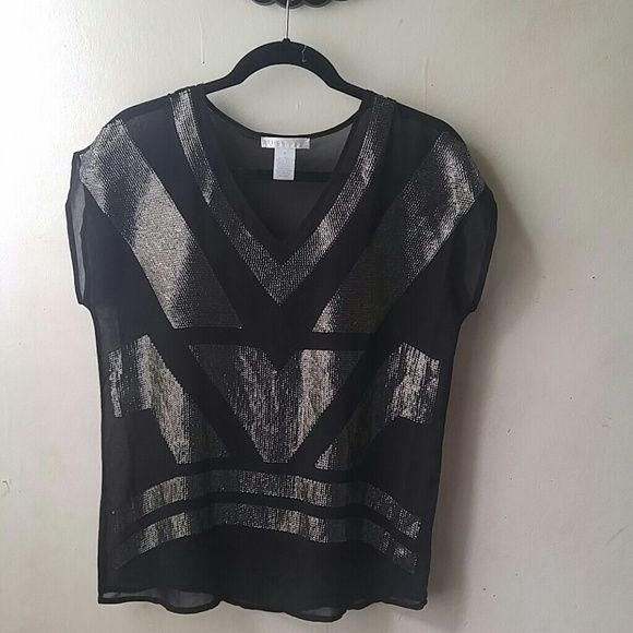 Adorable glitzy top Get your glam on girl. Very good condition. Chiffon top with attached cami. Muted pewter colored sequined design. 19 inches pit to pit., 24 inches in length. Command attention with this. Design history Tops