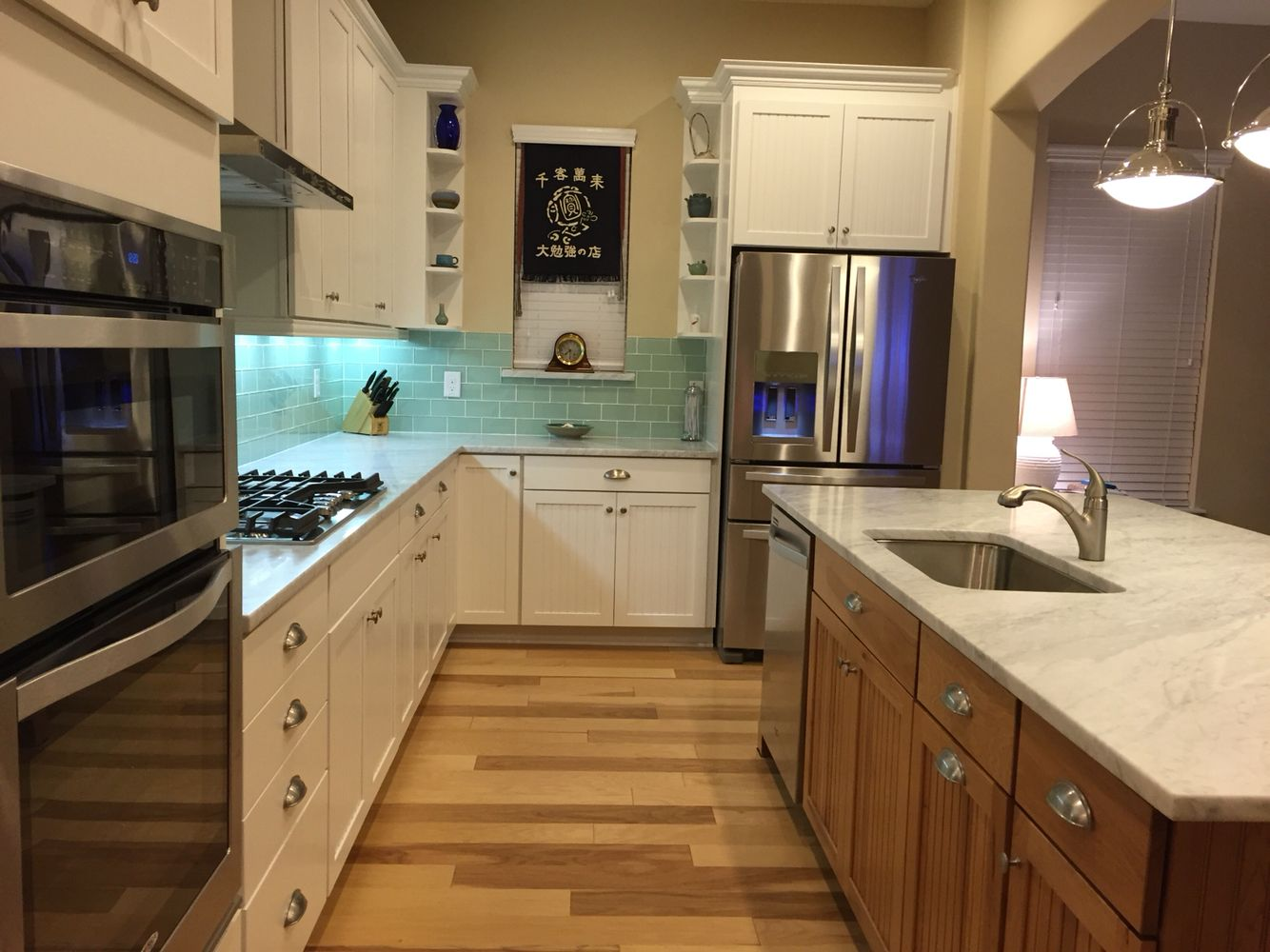 White Beadboard Kitchen Cabinets Kitchen With Marble Counters Sea Glass Subway Tile