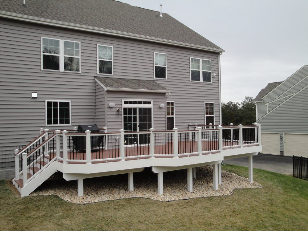 Trex Deck And Railings With Lanscape Stone Under Deck