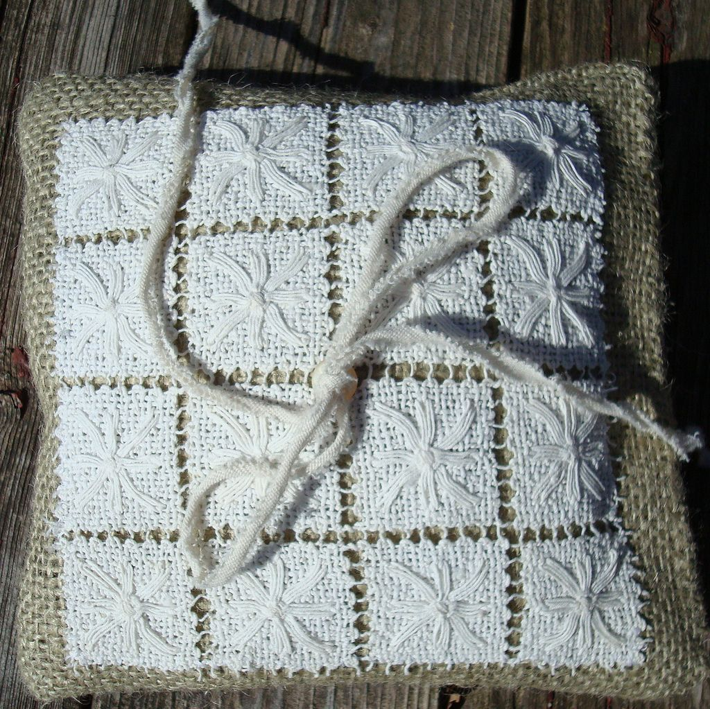 I like combining the elegance of antique lace with the rustic look and feel of burlap, as in this ringbearer pillow.