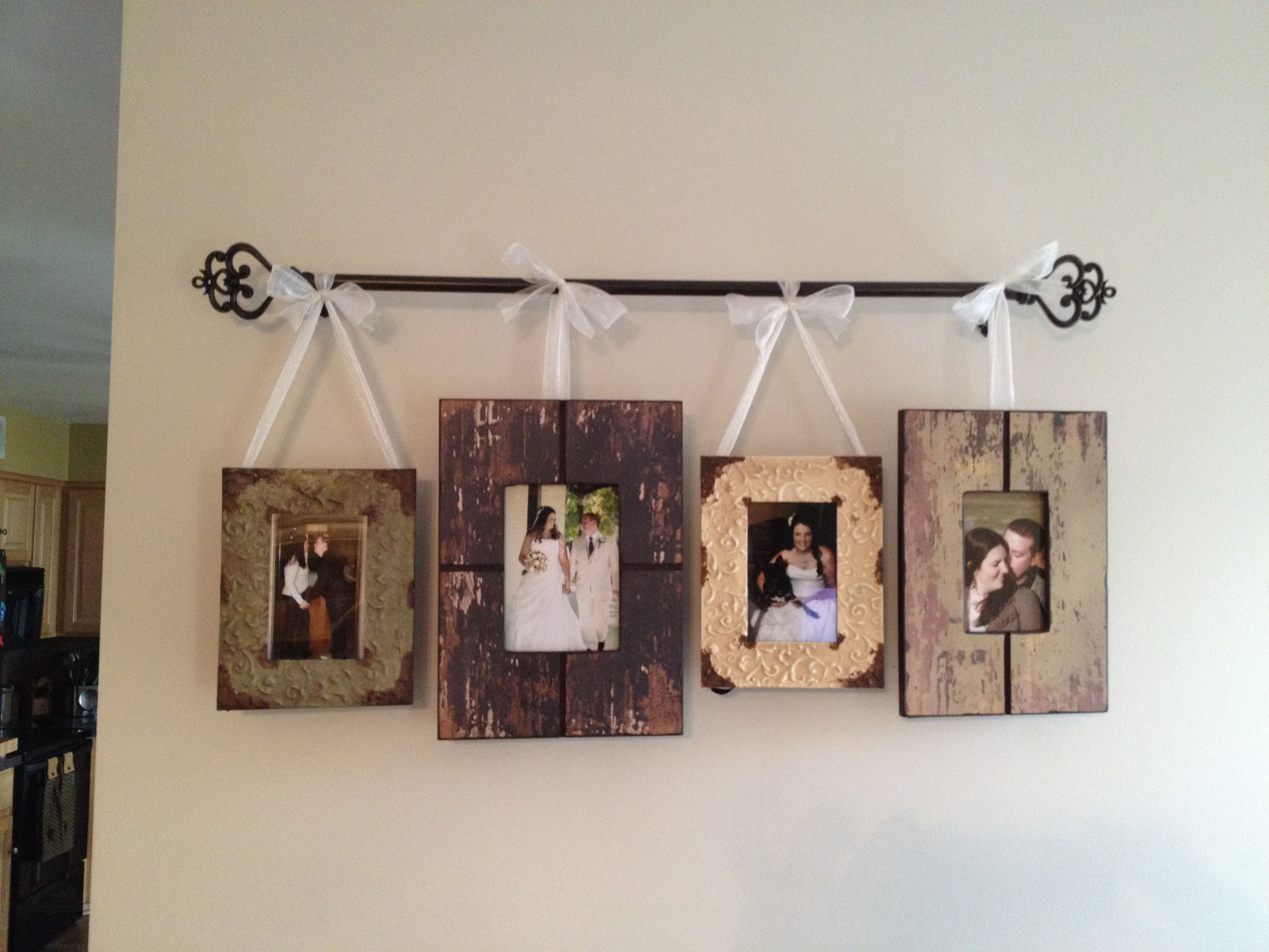 Frames On Curtain Rod With Ribbon