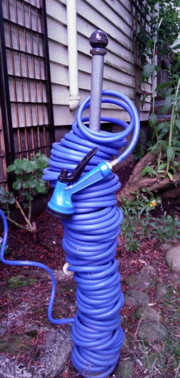 Simple Storage For A Coiled Hose To Prevent Kinking Conduit With