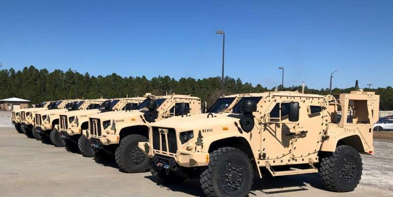 Military Car Lot >> A Military Vehicle Parked In A Parking Lot A Multitude Of