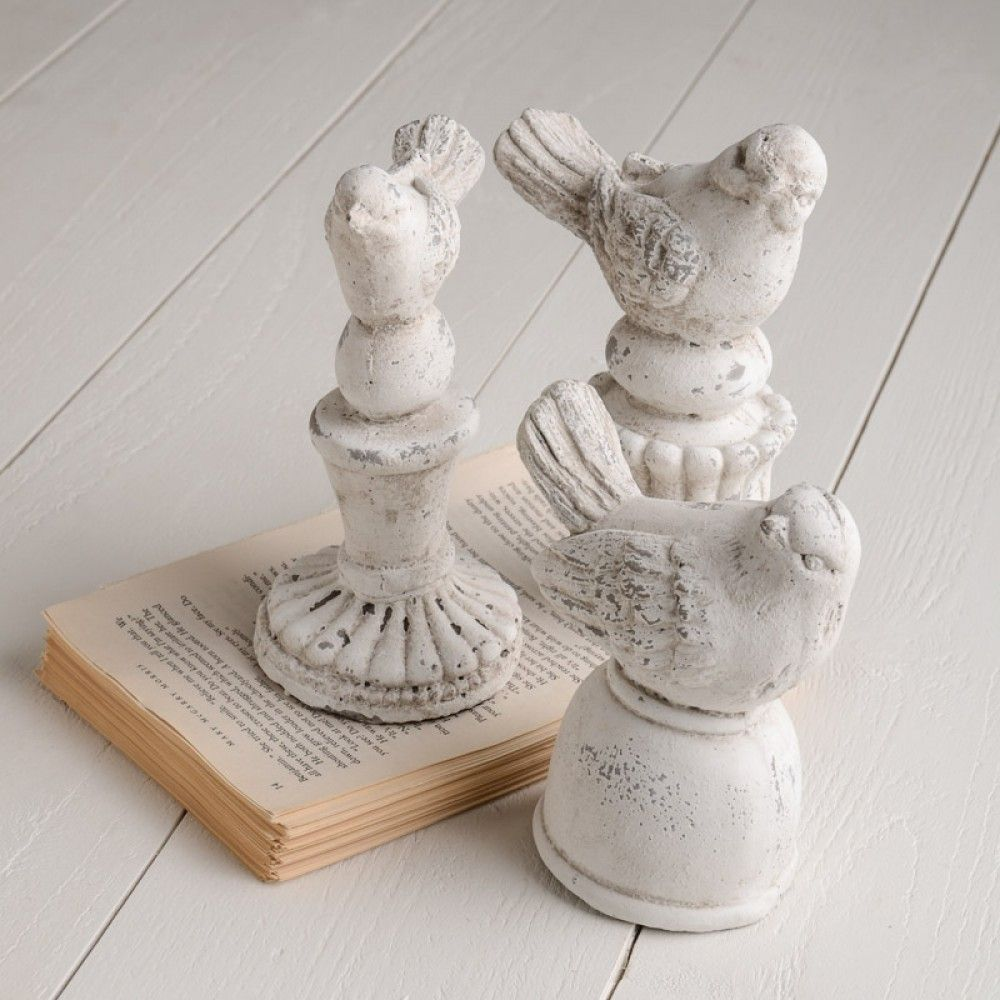 Sculpted Cement Birds. Safe for indoor and outdoor use. Available in plain mount, fluted mount, and ball mount.