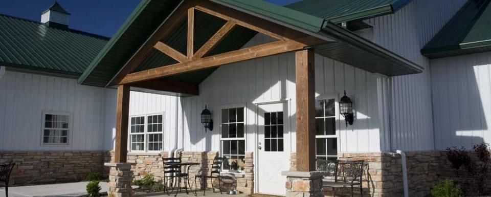 Metal buildings with porches post frame lake house for Barn with porch