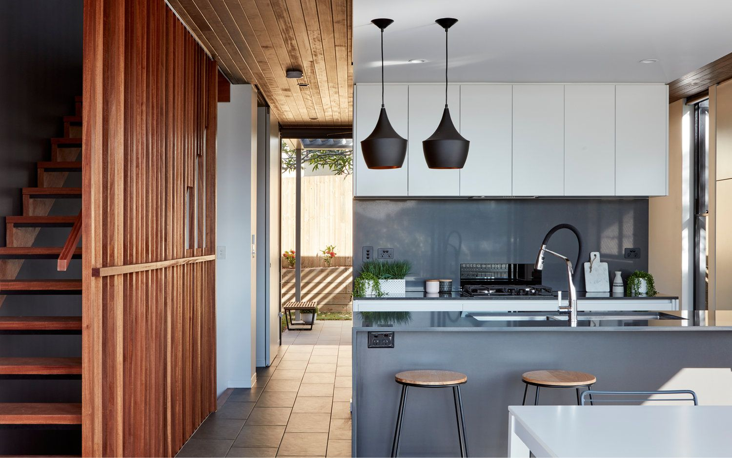 Shades of grey with white joinery are complimented by stained timber