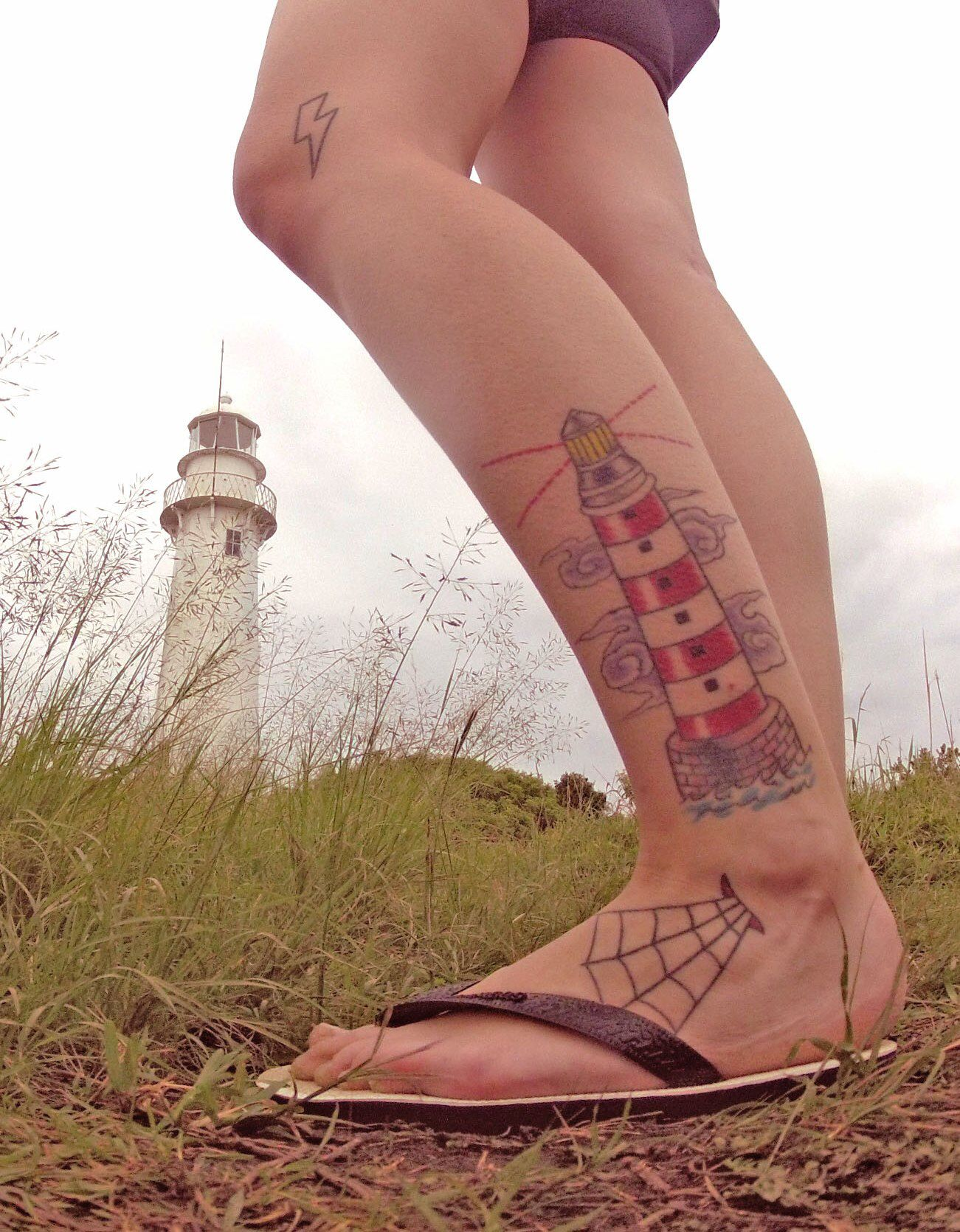 Tattoo lighthouse leg