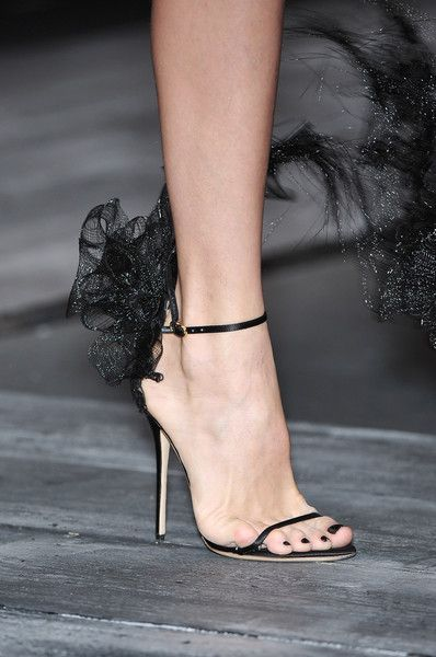 That little pinky toe is desperate to get out. Valentino heels.