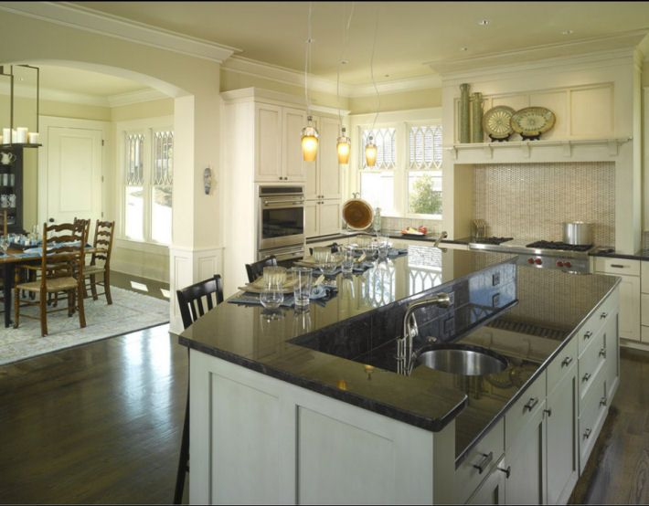 Kitchen Island 2 Tier a 2 tiered kitchen island shields a cooking mess from guests