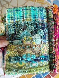 It would be fun to use my scraps from each quilt I make and do a page with a pocket and notes about that quilt and turn that into a fabric book.