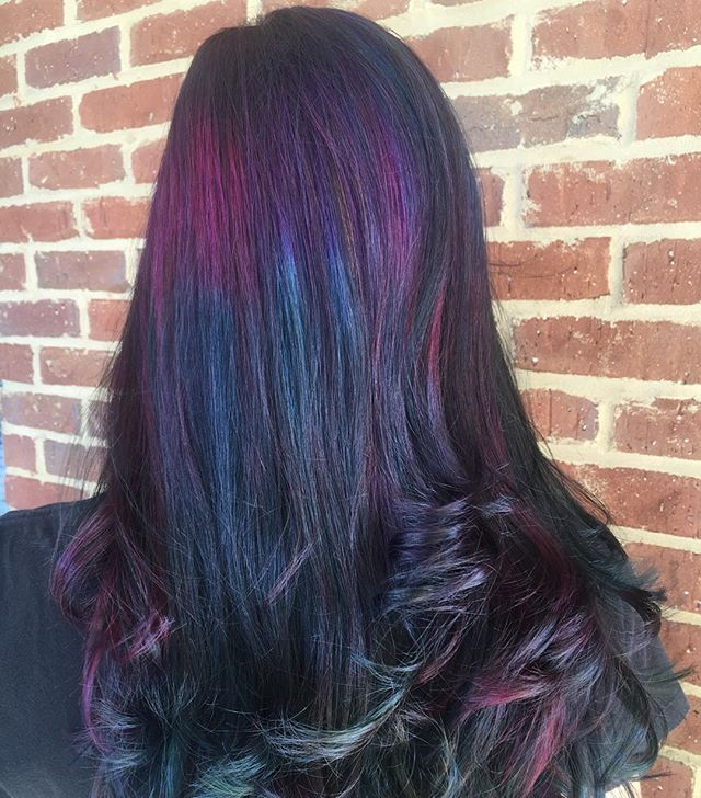 """""""Oil Slick Hair""""...a style that applies jewel tones over darker hair, giving it an iridescent appearance..New Hair Color Trend Is Actually Perfect for Brunettes..."""