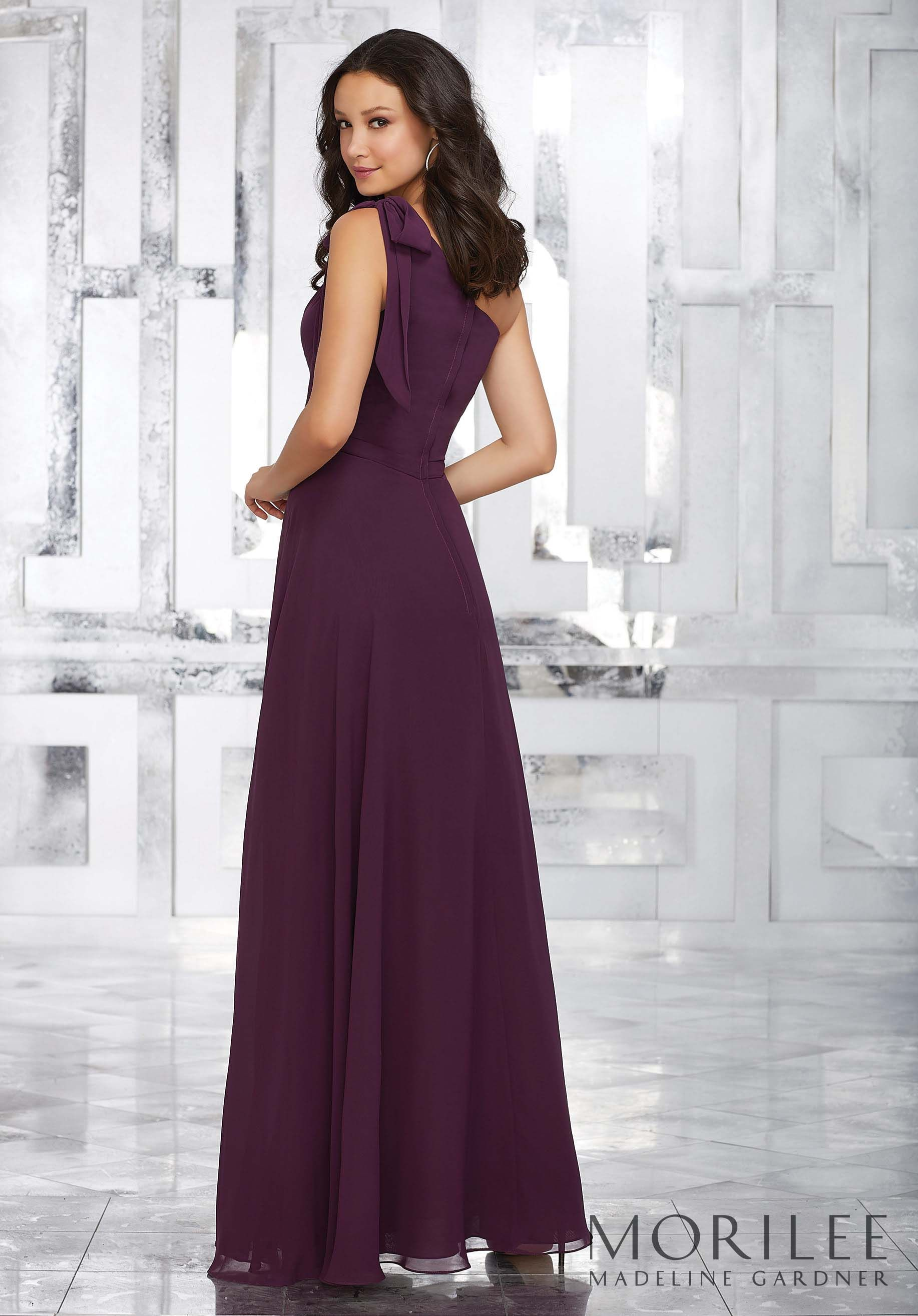 33f31ae4831 This Glamorous One Shoulder Chiffon Bridesmaid Dress Features a Removable  Shoulder Bow and Flowy A-line Silhouette. Available in 34 colors.