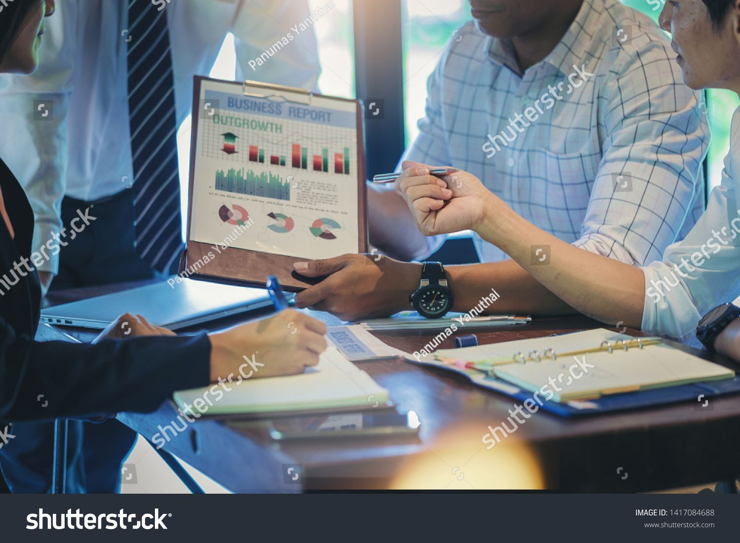 Businessman using hand gesture while explain business plan and discussion in the meeting Selected focus