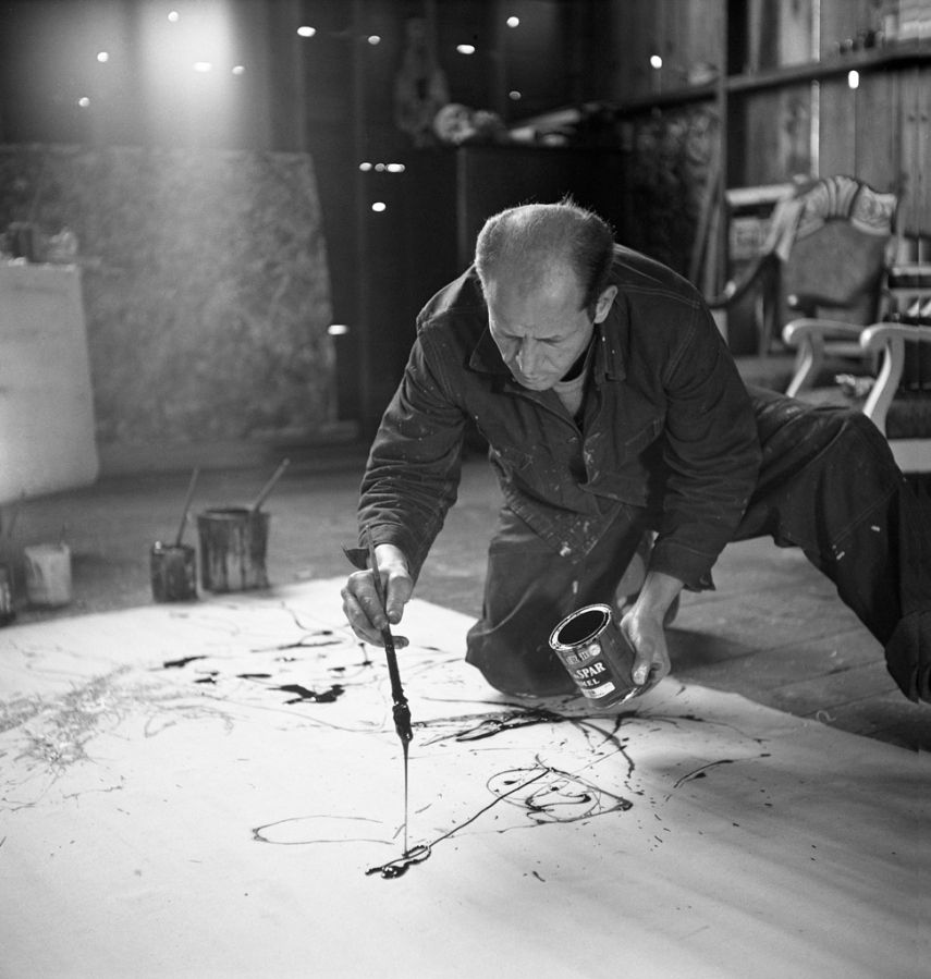 Instead of using an easel, Jackson Pollock would stretch a canvas on the floor of his barn and scamper around all four sides of it as he painted. Rather than using brushes, he used sticks to flick and drip paint, or he poured it straight from the can, favoring wet household enamels over traditional oils. (Martha Holmes—Time & Life Pictures/Getty Images) See more: http://ti.me/Rx5cqQ