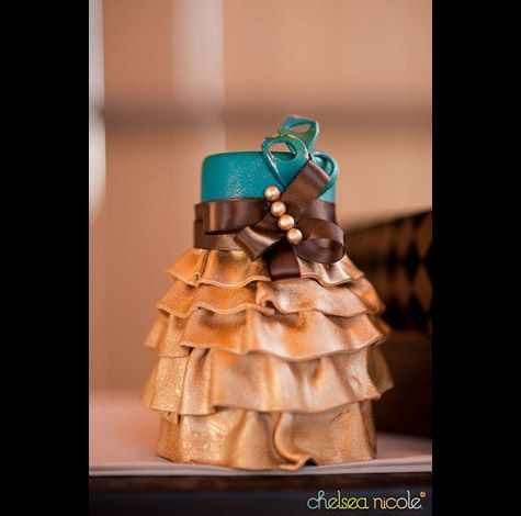 Love the ruffles...this one goes with the peacock cake.