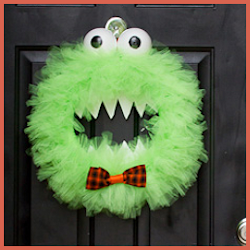 6 Fabulous Fall Wreath Ideas and Simple DIY Tutorials tulle monster wreath by Jill at BabyRabies.com and it's so simple to make but so creative! It could easily be reused at Christmas by adding a red Santa hat and relocating the eyes a bit to become The Grinch!  Very clever!