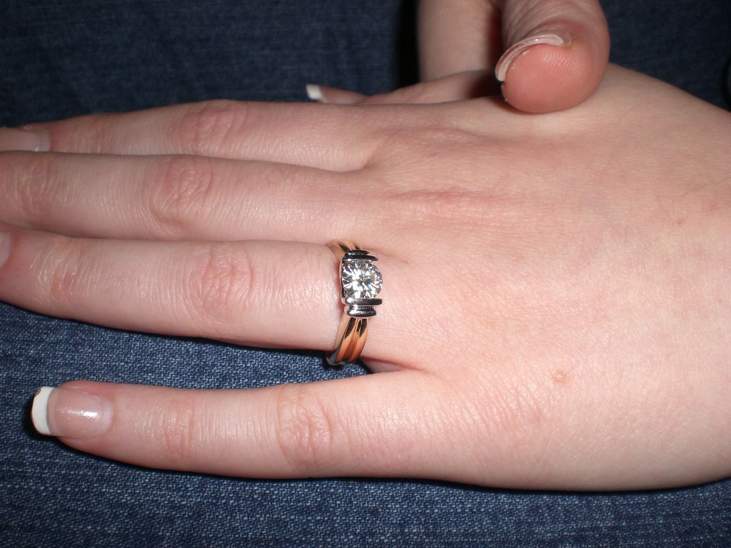 View of Cathy\'s shiny new engagement ring, from the side Today I ...