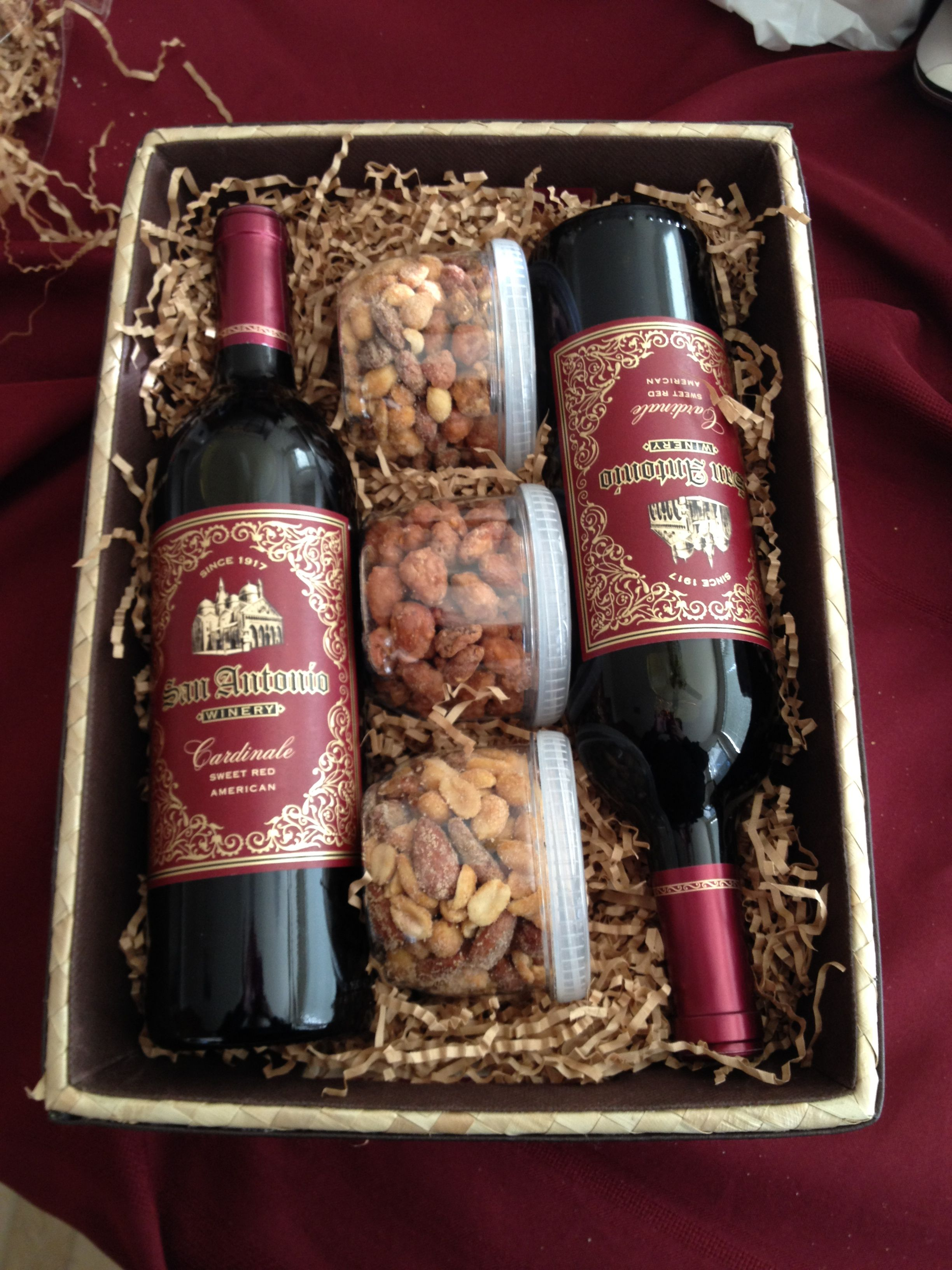 wine gift basket nuts are a good idea to add to the wine basket