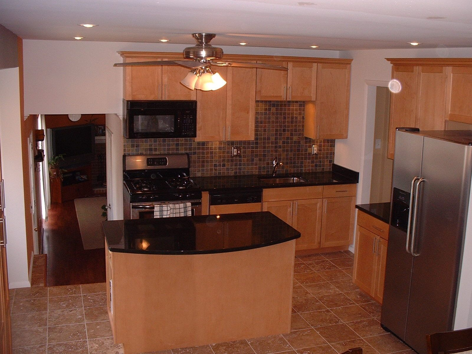 Kitchen with maple cabinets and real limestone flooring ... on Kitchen Tile Backsplash Ideas With Maple Cabinets  id=86424