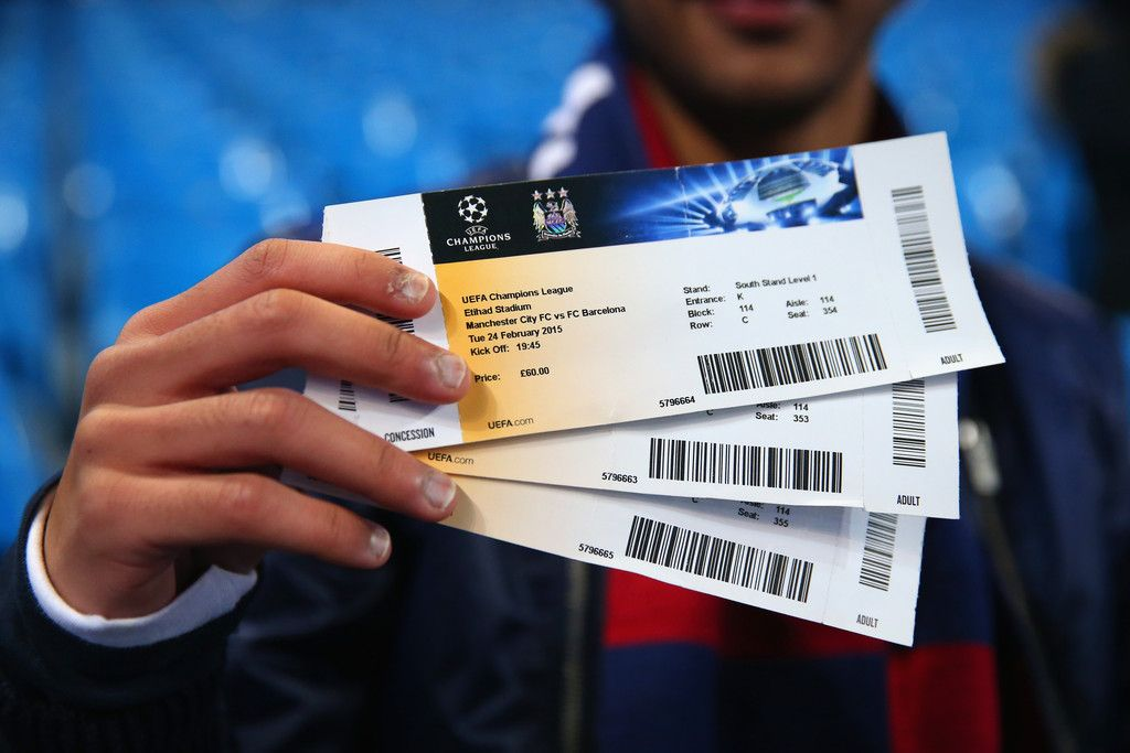 a fan holds up his match day tickets prior to the uefa champions league round of