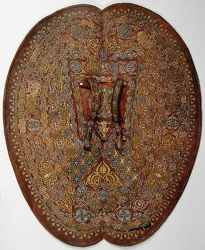 "Moorish shield (adarga), 15th century, Kunsthistorisches Museum Vienna. The adarga was a hard leather shield used originally by the Moors of Spain, its name derived from the Arabic ""al-daraqa"" (""shield"")."