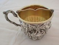 "Men's Shaving Mug #450    Sterling, nouveau style with florals and ""twig"" handle    This example is from 1916"