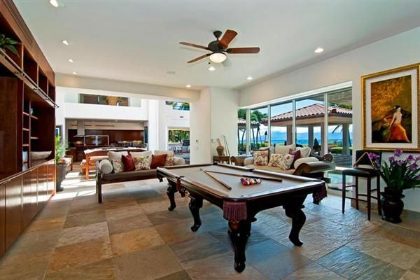 Living room with pool table. With the bowling alley, indoor theater etc... Had to squeeze pool table in somewhere.