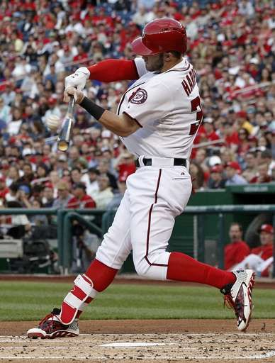 Washington Nationals' Bryce Harper hits a solo home run during the second inning of a baseball game against the Philadelphia Phillies at Nationals Park, Friday, May 22, 2015, in Washington. - © AP Photo/Alex Brandon