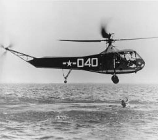 Coast Guard's test of the capability of Navy's first helicopter, HNS-1 (Army R-4 Sikorsky), for air-sea rescue at NAS New York during World War II.
