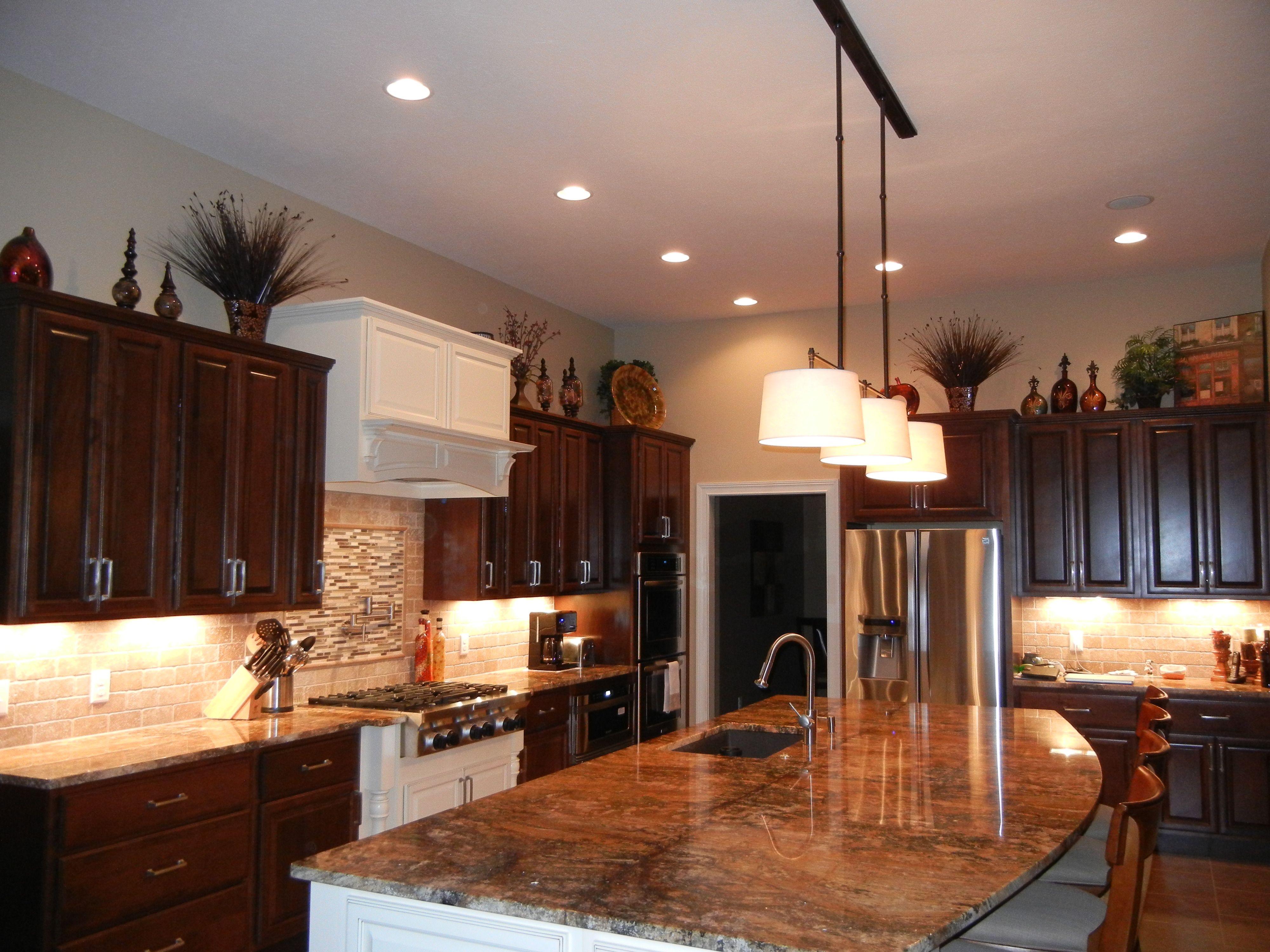 Visual Comfort Light Fixture. Mascarella Granite. HAAS Cabinetry. Kitchen Aide Appliances.
