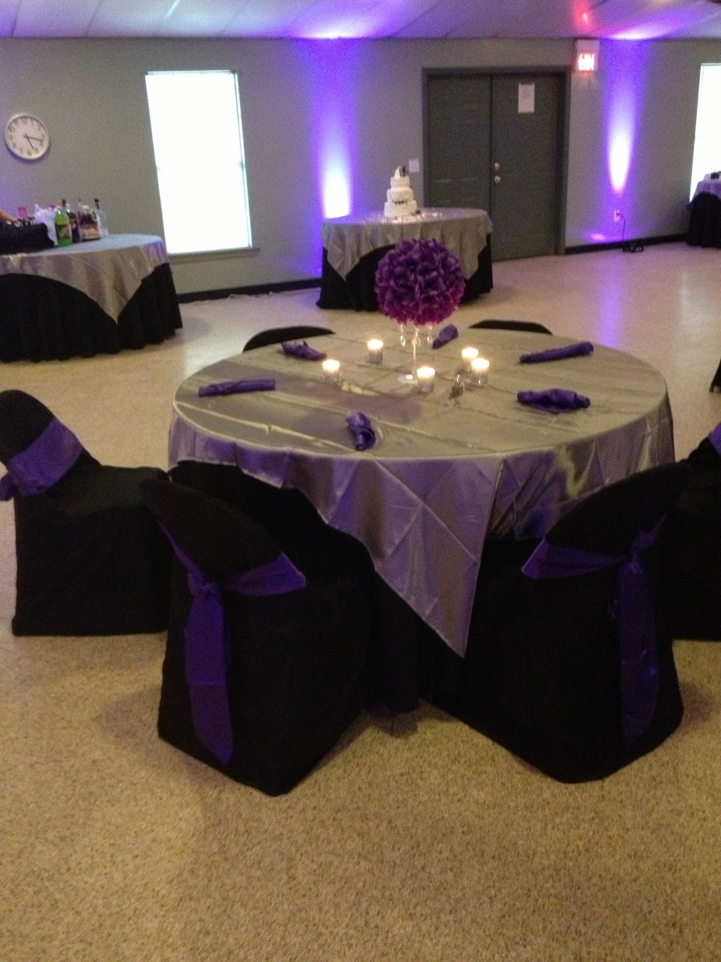 Purple, black, silver table decoration.