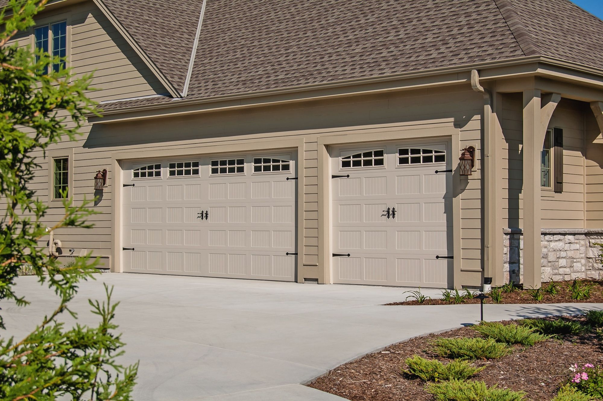 Rustic Craftsmanship Brings Unparalleled Warmth And Individuality To Chi S Line Of Carriage House Style Garage Doors Built With Handcrafted Details A