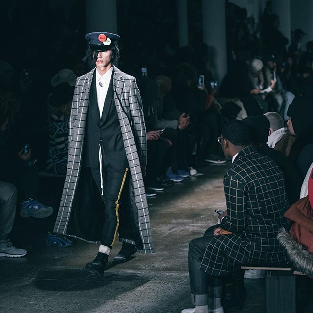 AW16/// Look 7. Takahiro in a floor length overcoat with an athletic inspired tuxedo. #pyermoss
