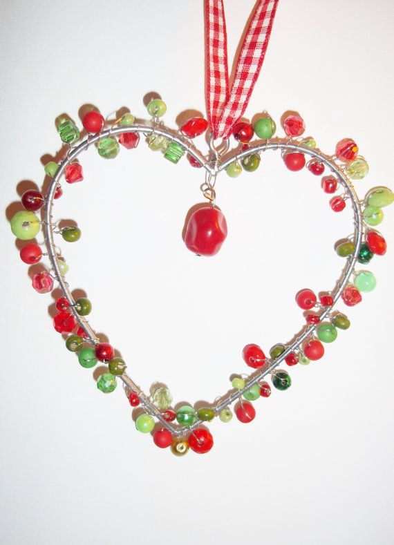 A Christmas beaded wall/window/tree display wire heart decorated in ...