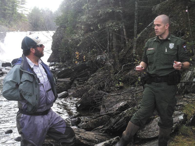 Maine game warden warden fish man outdoorsman