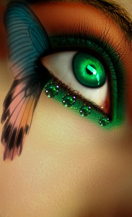 Beautiful butterfly themed eye makeup enhanced with four emerald gems.