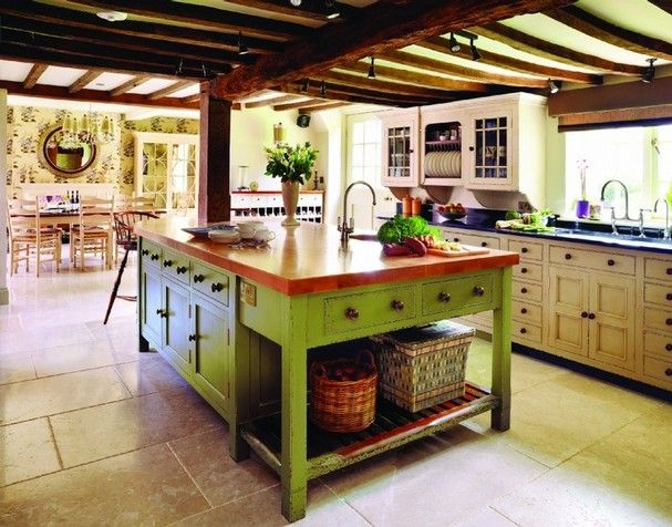 I'm crazy about this chartreuse oversized work station. The butcher block looks outstanding and the color combination gives the kitchen a bright focal piece.