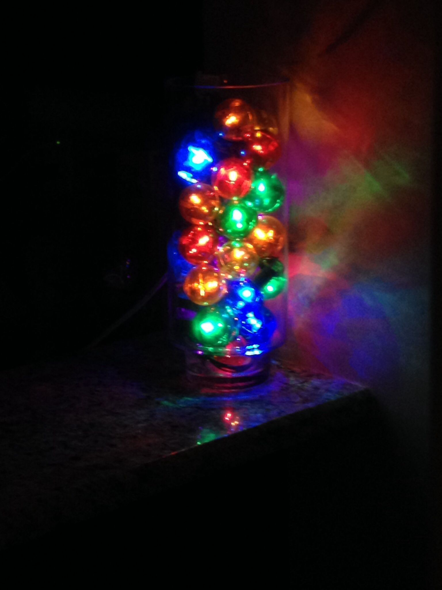 Christmas lights in a vase/hurricane makes a great Christmas decoration!