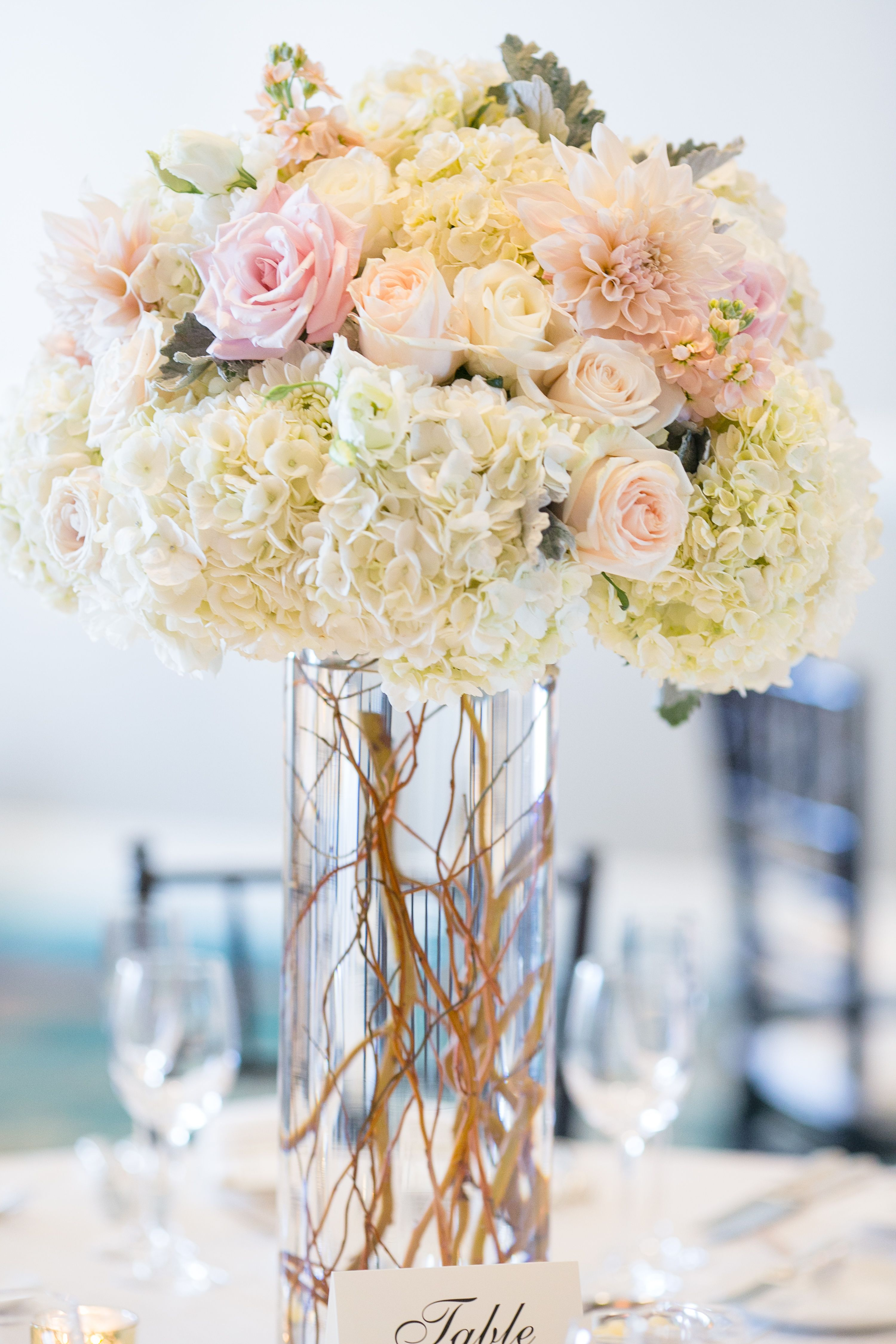 Blush and white tall centerpiece. Dahlias, hydrangea, curly willow ...