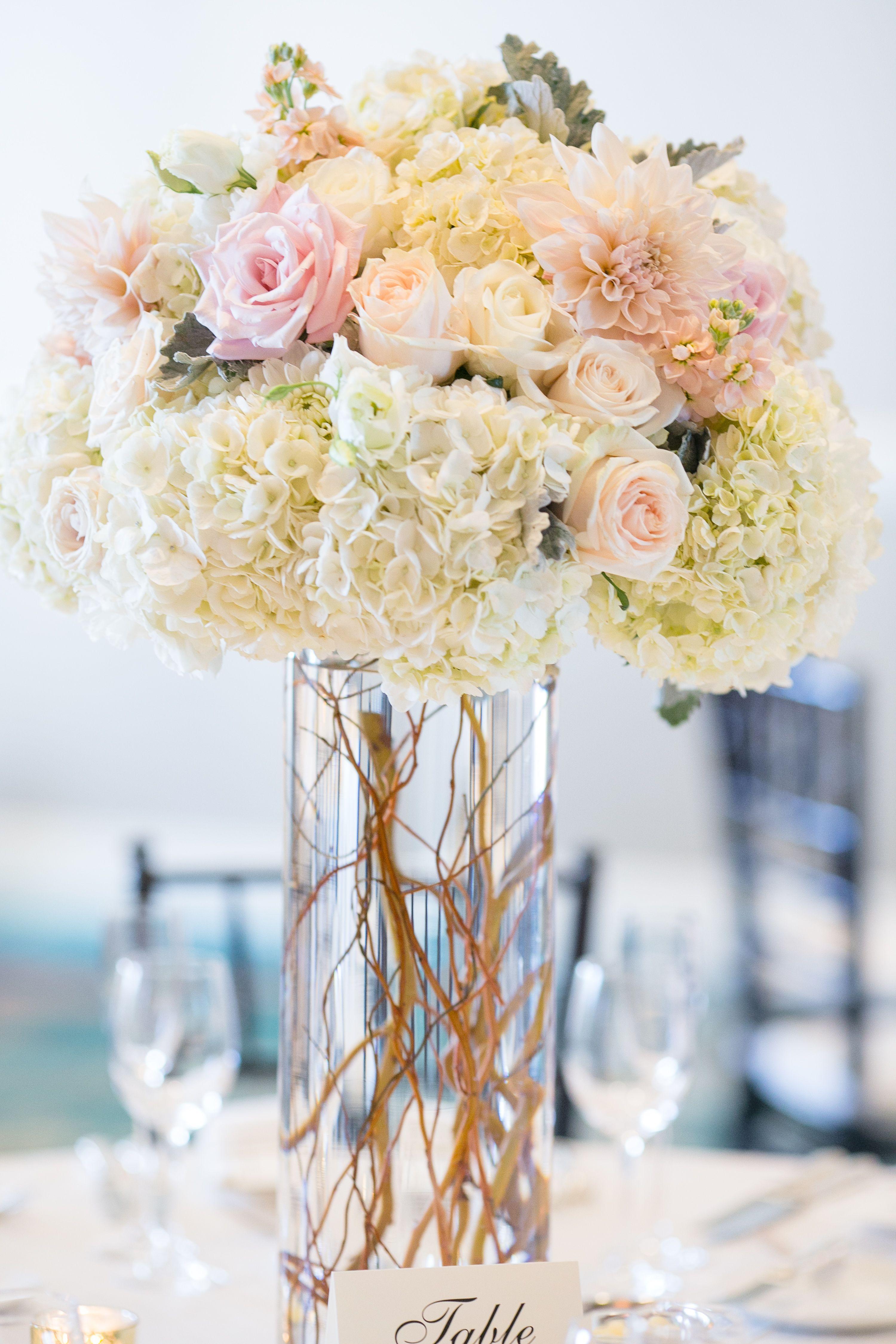 blush and white tall centerpiece. dahlias, hydrangea, curly