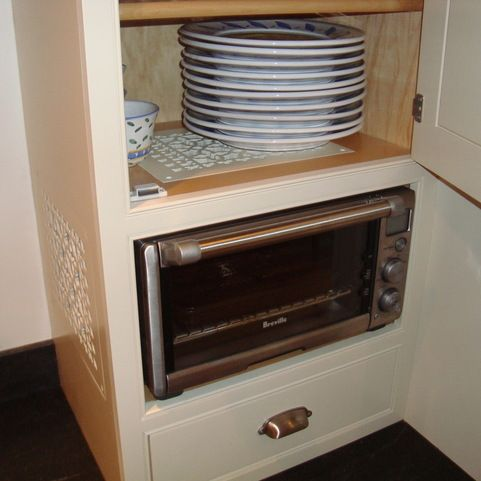 Toaster Oven In A Dedicated Cubby With Venting For Heat Built