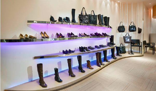 international decor brands product display lighting retail brand joy peace shoes