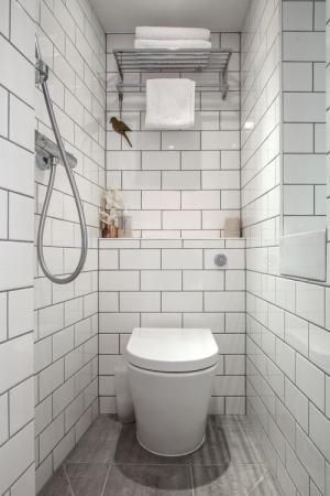 7 Tiny Bathrooms Brimming With Functional And Beautiful Ideas Small Wet Room Wet Room Bathroom Tiny Bathrooms