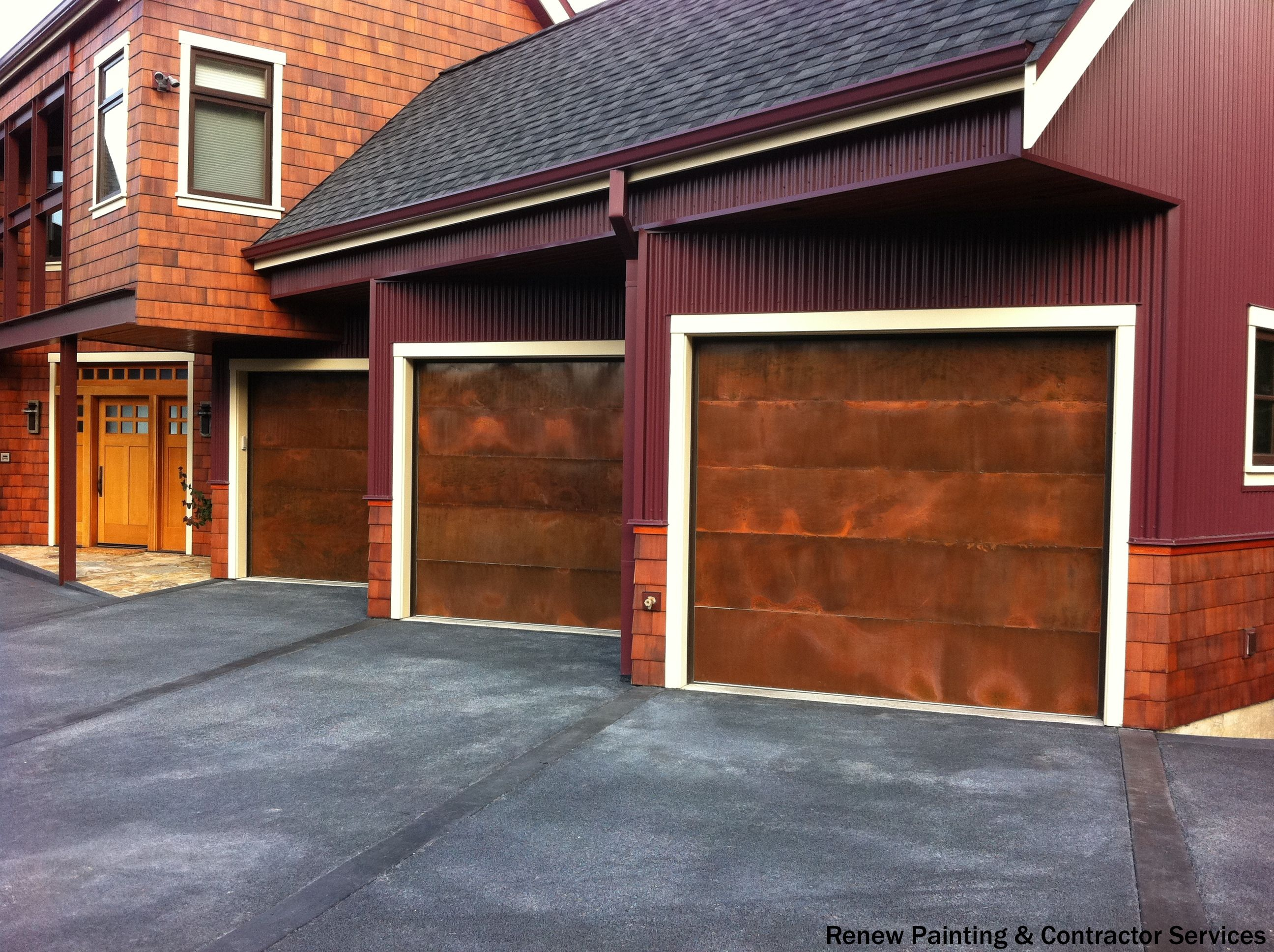 Very unique 3-car, angled garage with a nice burgundy painted siding and paved driveway. If you are looking to repair or remodel your garage door, see what it will cost you.