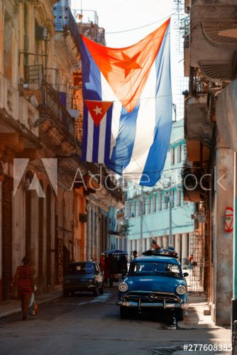 Antique car and cuban flag in Old Havana - Buy this stock photo and explore similar images at Adobe Stock