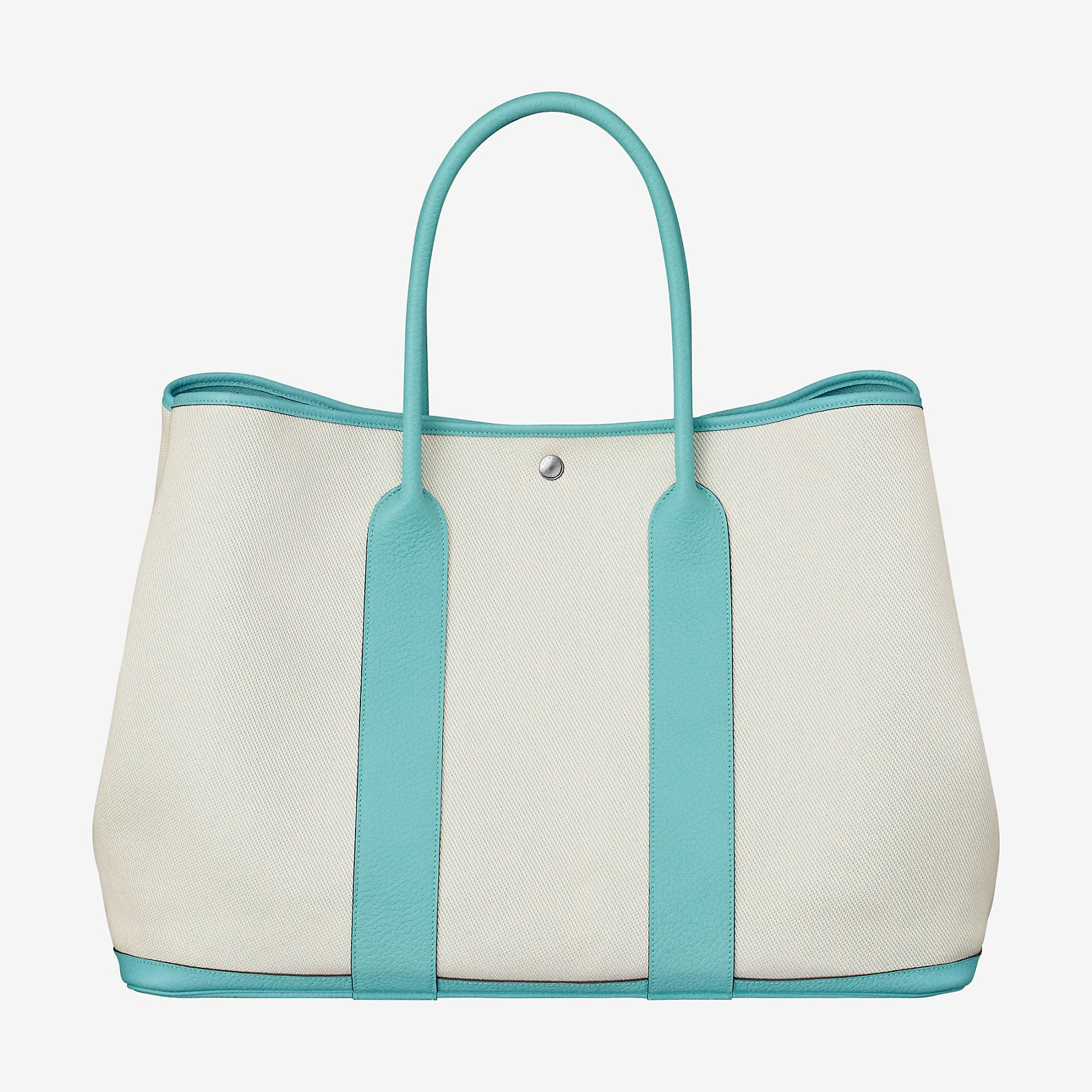 87940d35b941 Hermes bag in twill H canvas and cowhide. Silver and palladium plated Clou  de Selle snap closure.