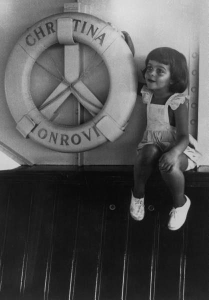 "Little Christina Onassis on board her father Ari's legendary yaght ""Christina'"