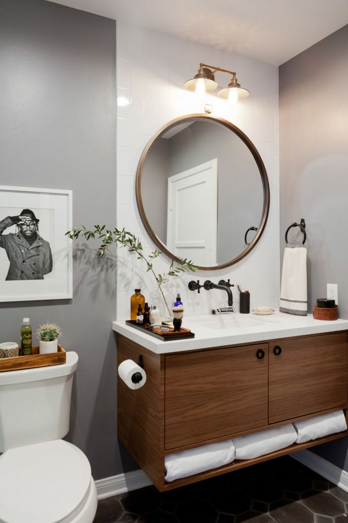 Deciding on the right bathroom mirror is a tough one — framed or frameless? Round or rectangle? Single or multiple?