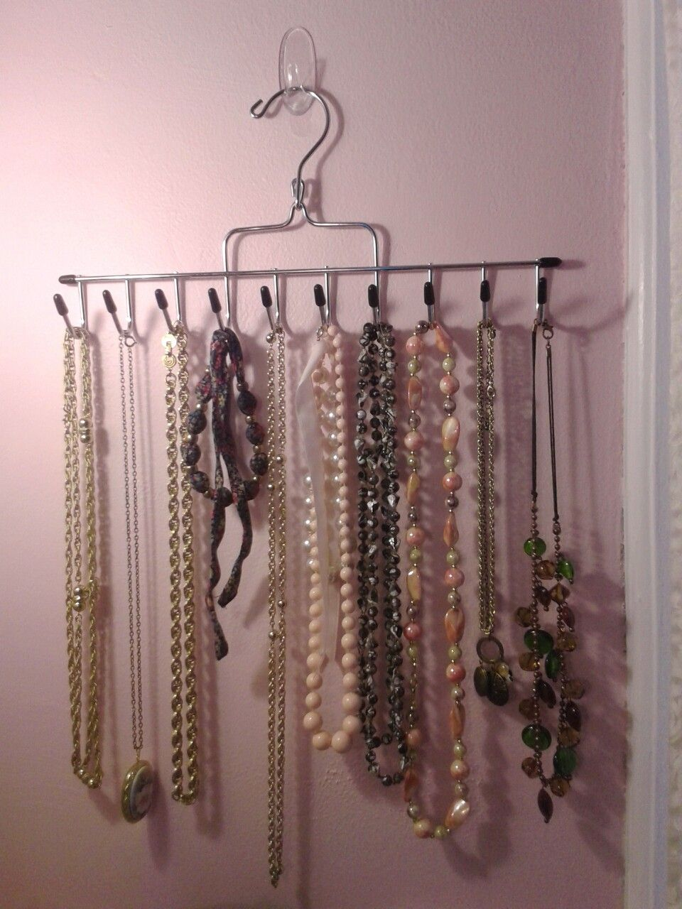A great way to organize jewelry! A command strips hook and a
