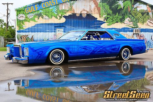 Leal Bros Lincoln on a rainy day... http://on.fb.me/1lbZj37 #lincoln #continental #lowrider #streetseen @LBcitystyle